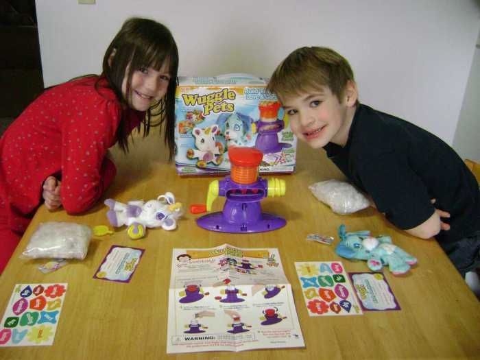 The kiddos with the contents of the Wuggle Pets Starter Kit