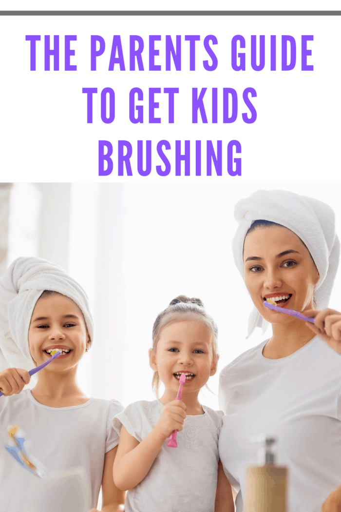 mother with two small girls brushing teeth together