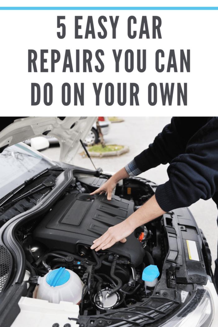 man doing car repairs
