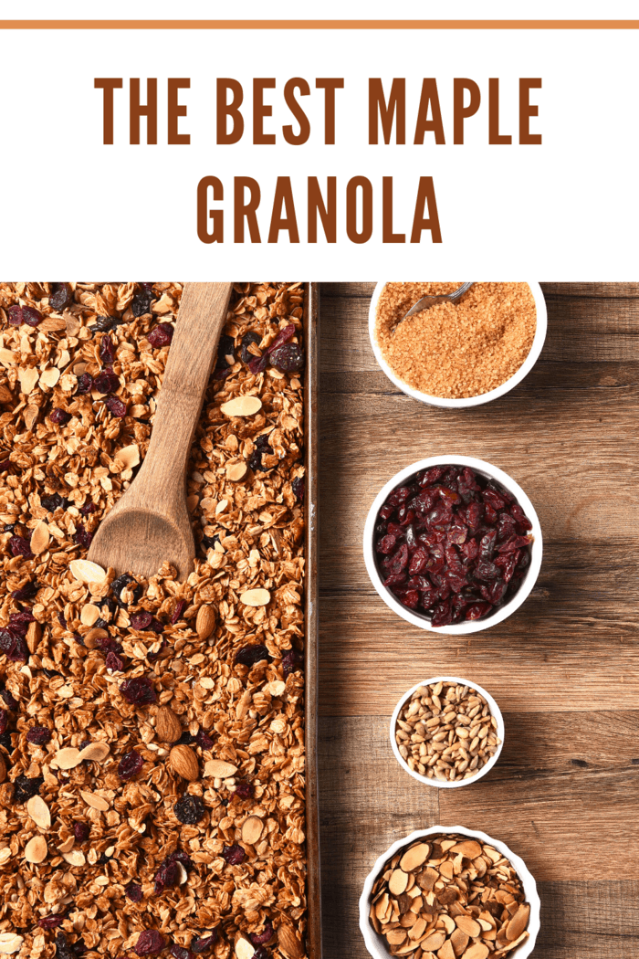 maple granola on baking sheet with ingredients in small bowls.