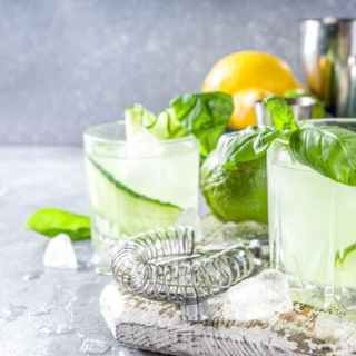 This Basil and Cucumber Smash recipe creates a light and fragrant cocktail, muddled with basil leaves, cucumber, and ice, then finished off with gin and a splash of club soda.