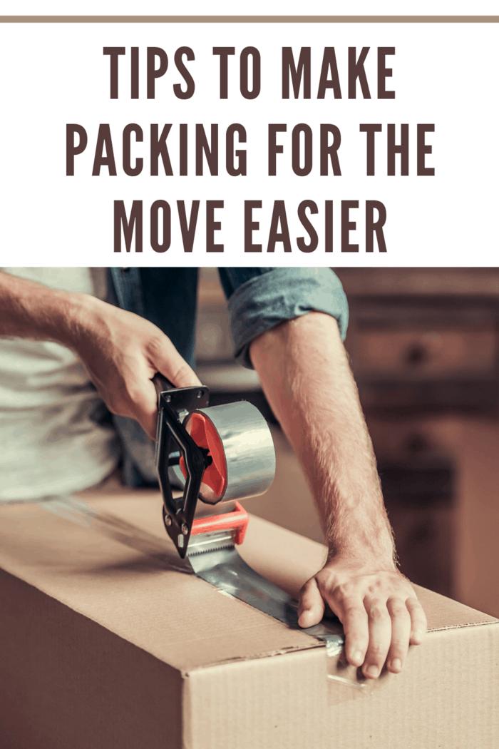 man using packing tape to seal moving box