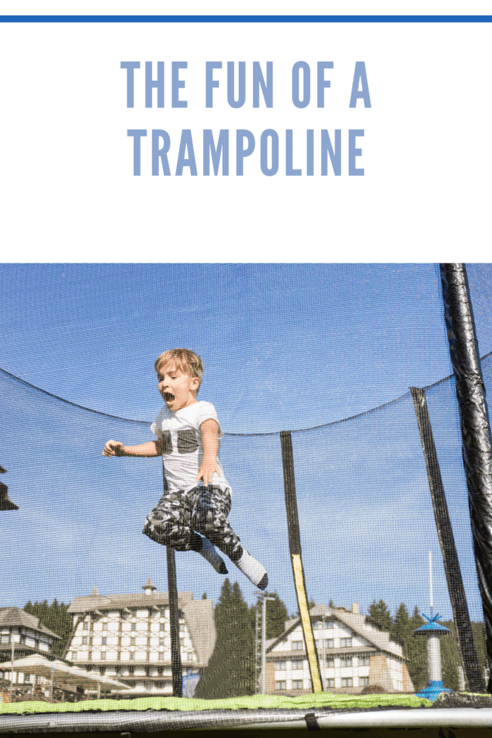 little boy in the air jumping on trampoline