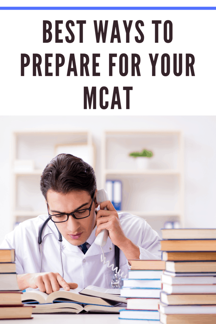 man studying for mcat with books, telephone