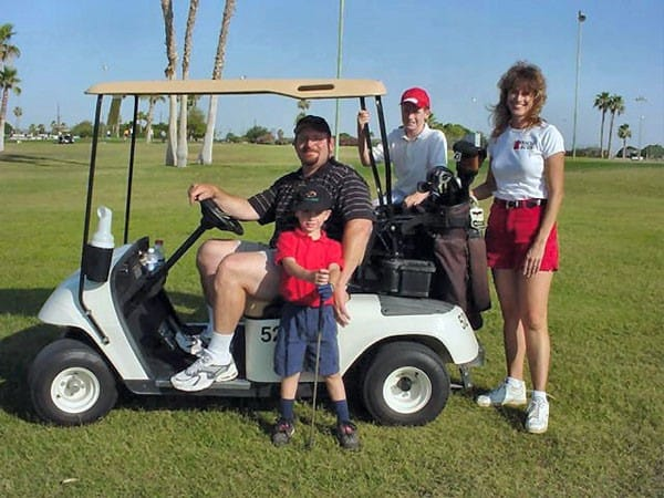 golf cart with family gathered around