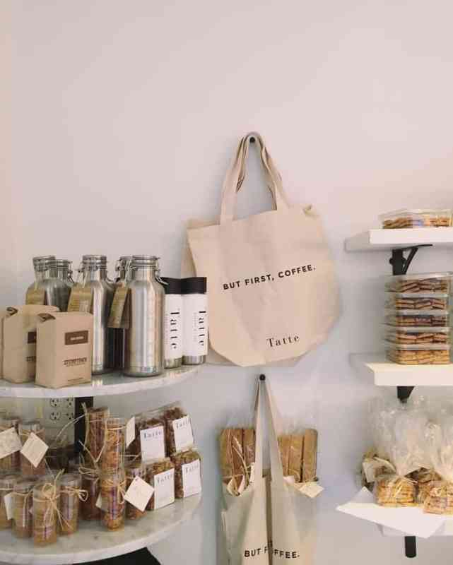 printed canvas bags hanging on wall