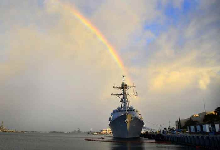 Pearl Harbor with rainbow over ship