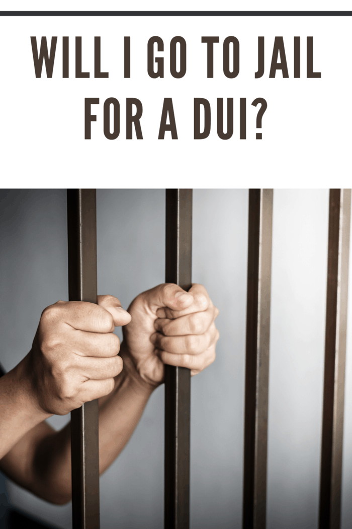 jail bars with hands holding them