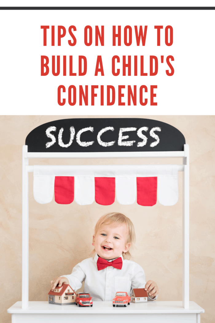 little boy in bow tie at success stand
