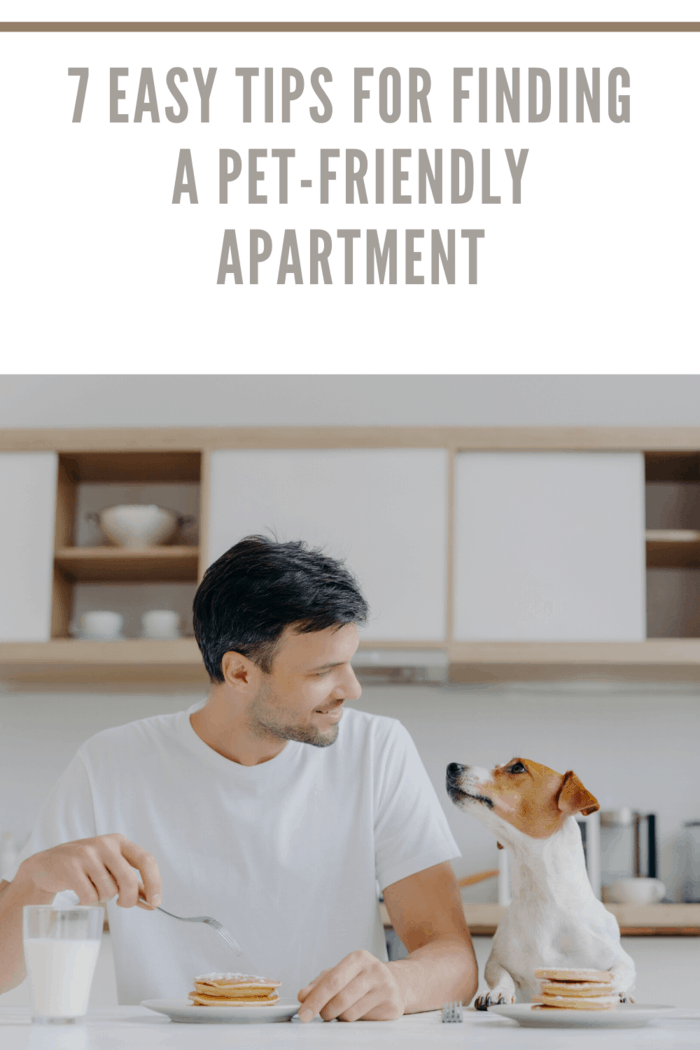 man eating breakfast with dog in their pet-friendly apartment