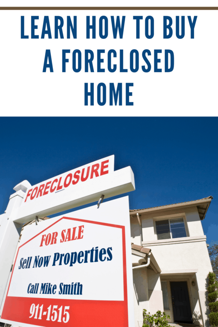 foreclosed home with real estate agent sign