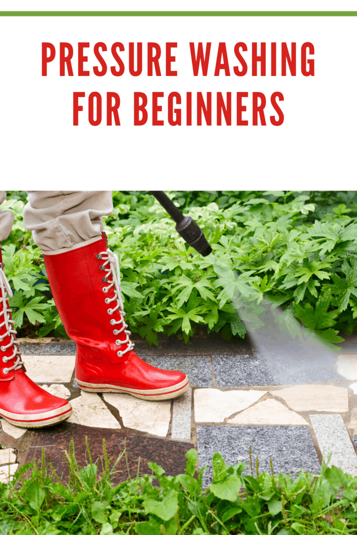 red rainboots on walkway being pressure washed