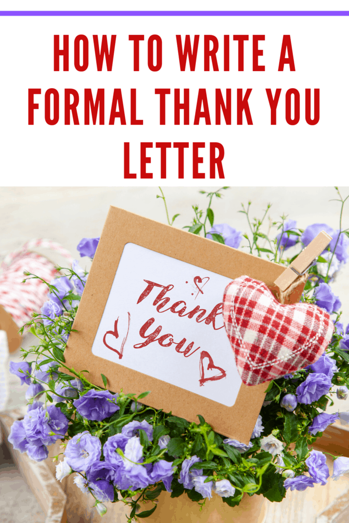 formal thank you letter in bouquet of flowers with heart embellishement