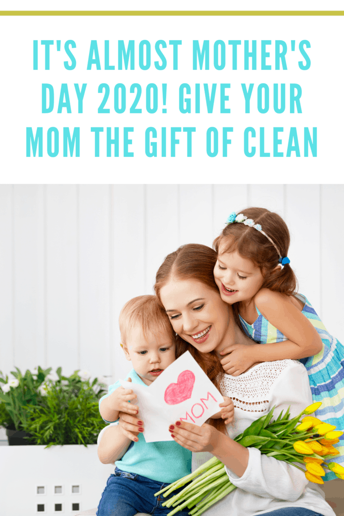 mom opening homemade mother's day card with kids-Mom deserves some pampering and we share 7 reasons mom deserves the gift of clean this Mother's Day hire a cleaning service.
