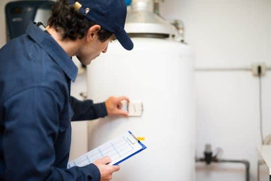 water heater inspector checking water heater