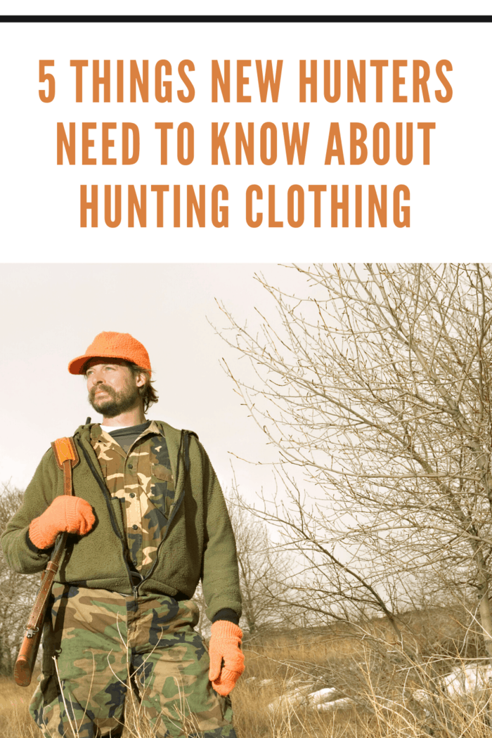 hunter wearing hunter orange hat and gloves with camoflauge tee shirt and pants