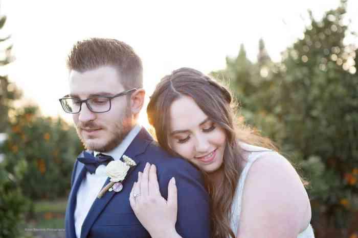 bride leaning on grooms shoulder