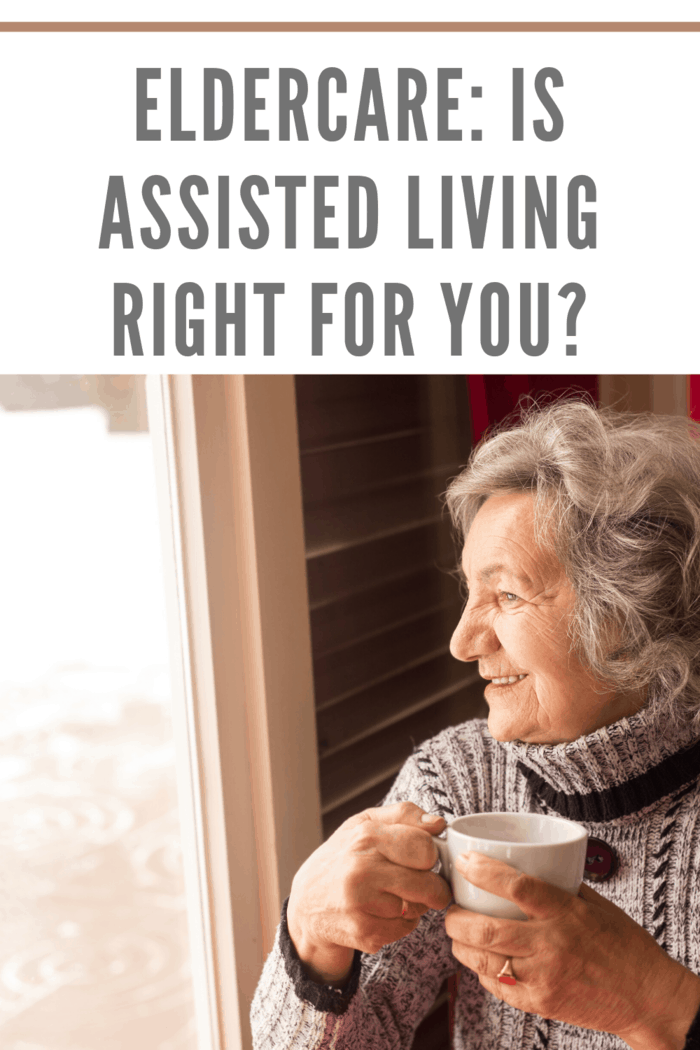woman enjoying cup of coffee while looking outside through window at assisted living facility