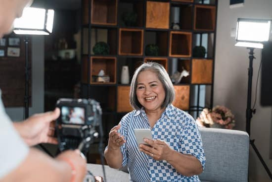 Old women making a video for her blog on mobile phone technology