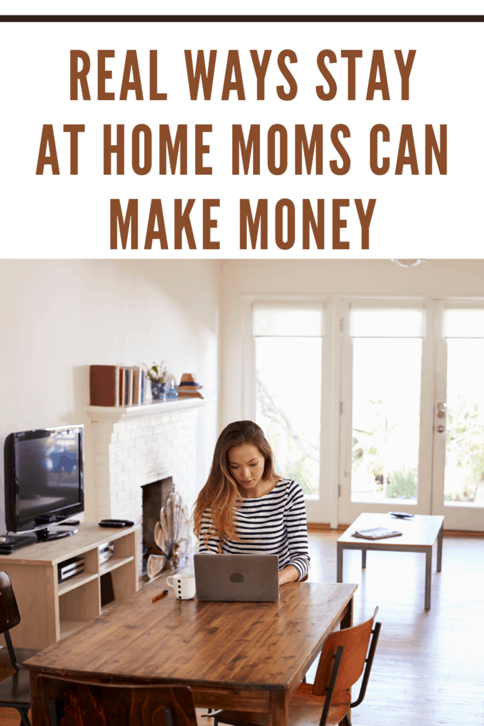 mom working at kitchen table on computer making money