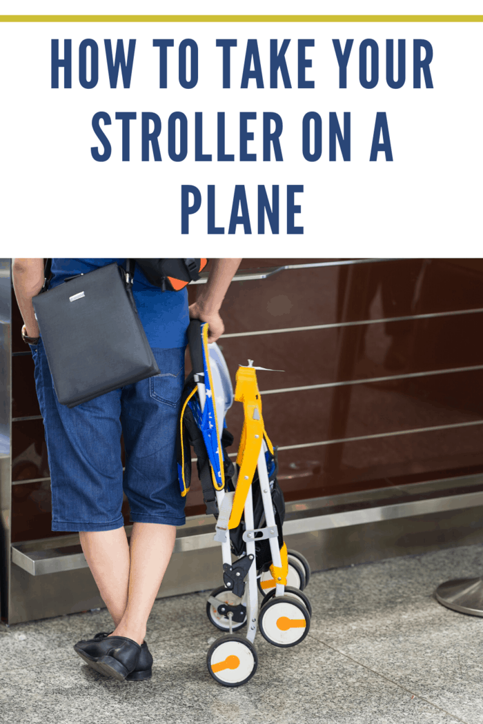 man standing at airport waiting to get folded stroller on a plane