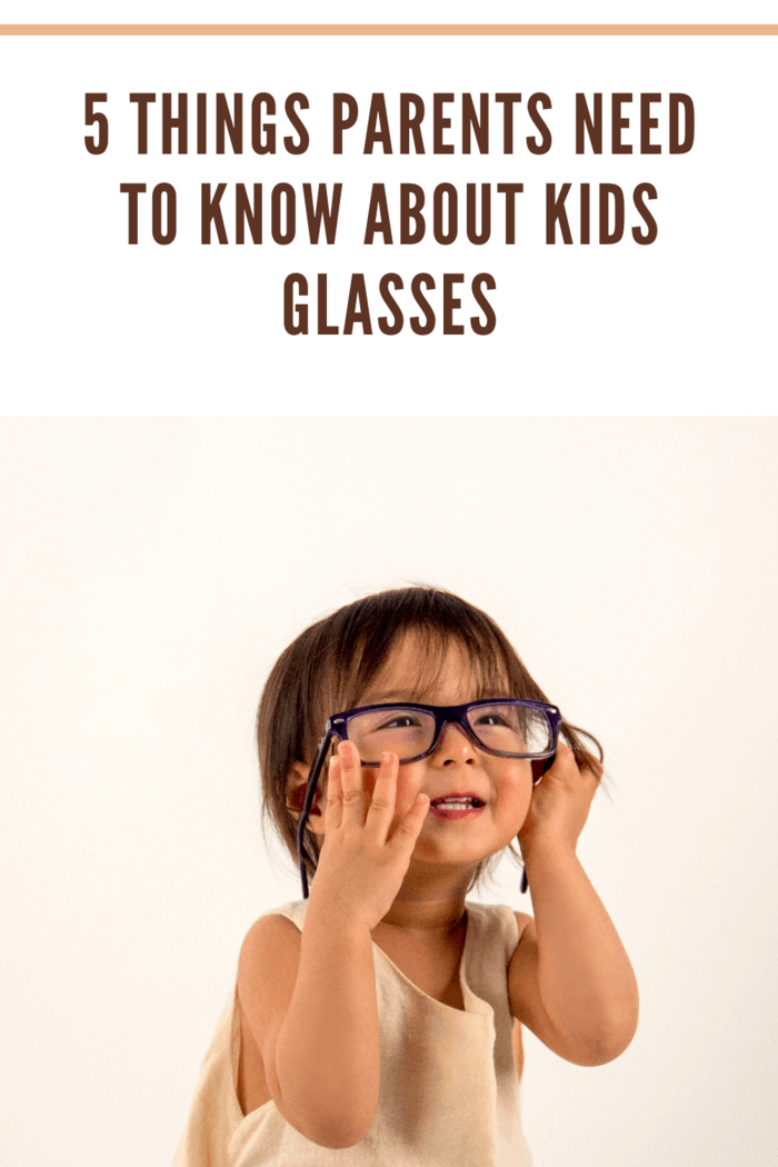little girl with adult glasses on