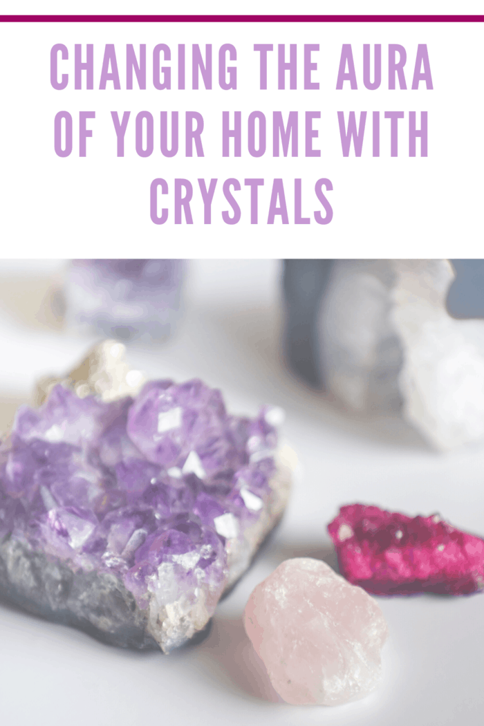 amethyst, rose quartz and other crystals resting on table.