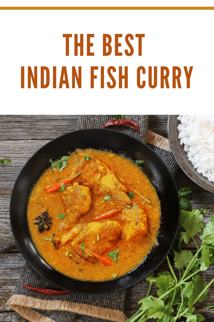 fish curry in pan garnished with herbs ready to serve
