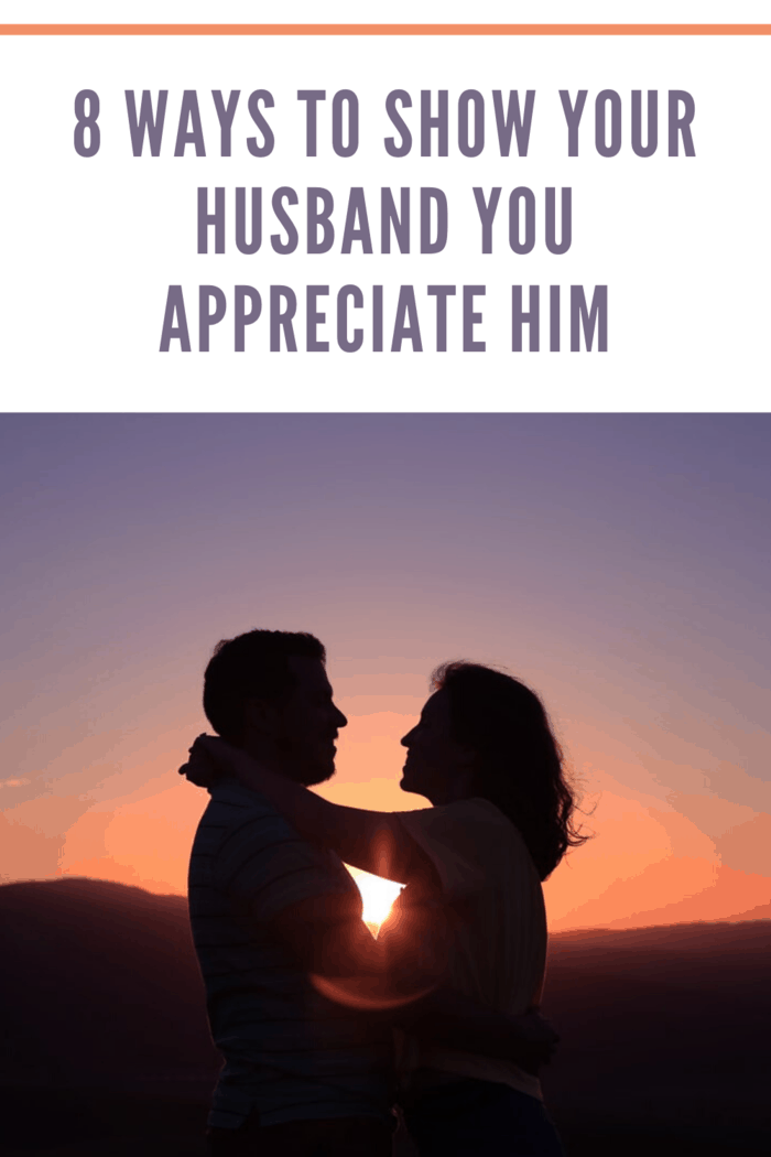sunset with silhouettes of husband and wife hugging