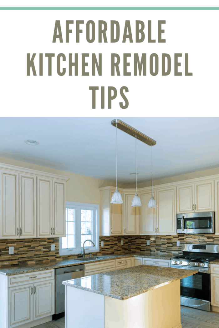 white kitchen remodel with tile backsplash and granite countertops