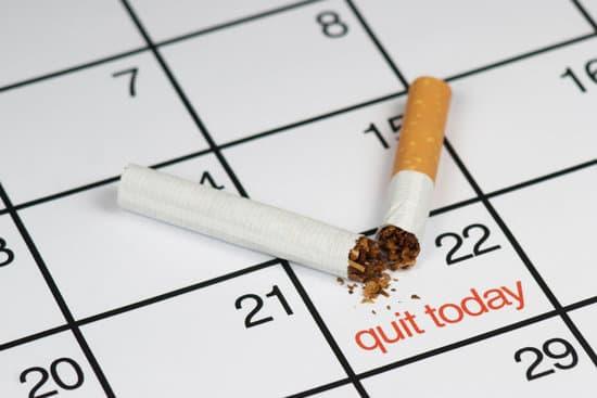 """A broken cigarette above a calendar, saying quit today"""