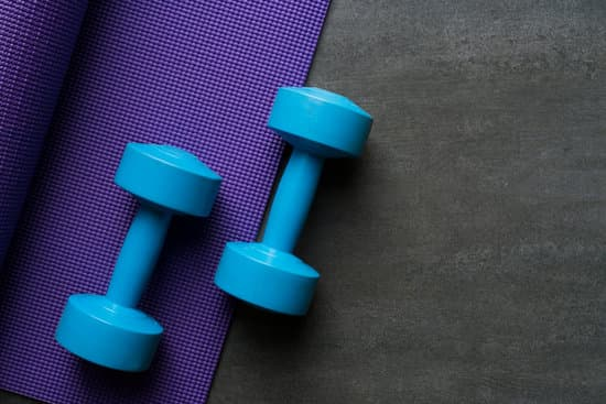 purple exercise mat with blue dumb bells