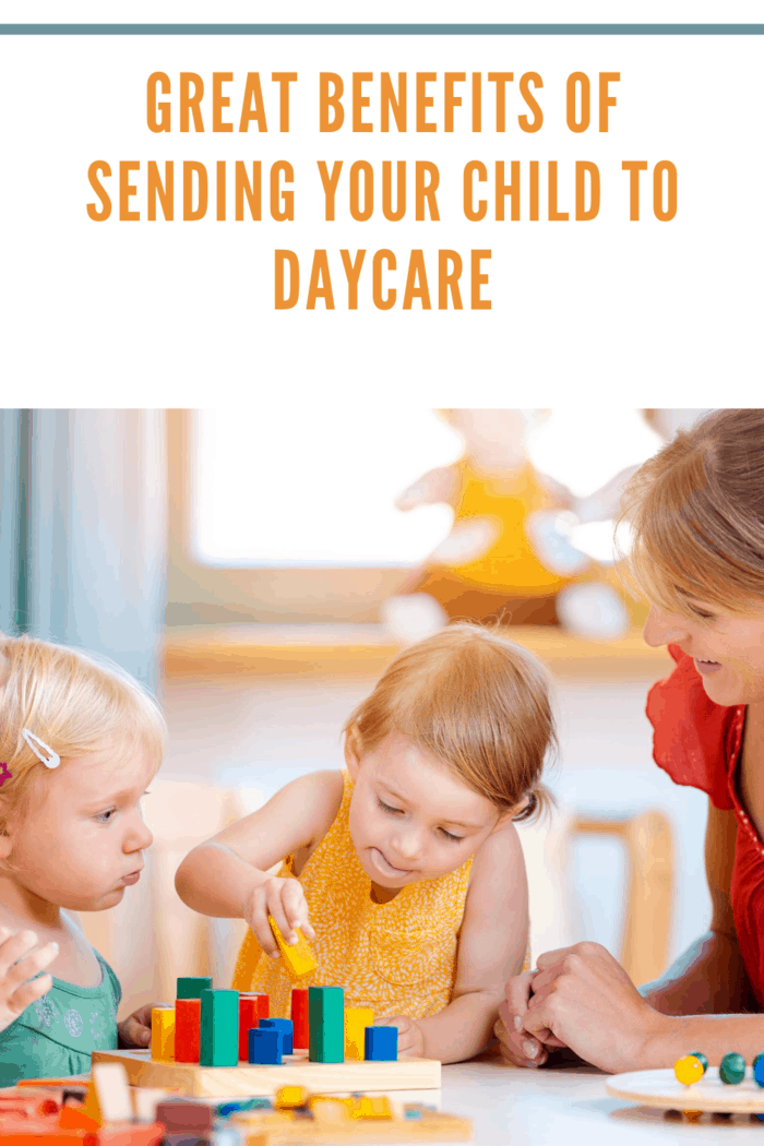 children at daycare sitting with daycare teacher