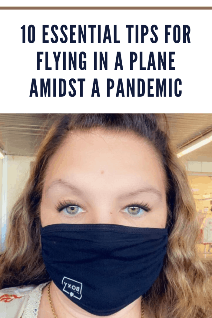 woman wearing a black face mask at the airport