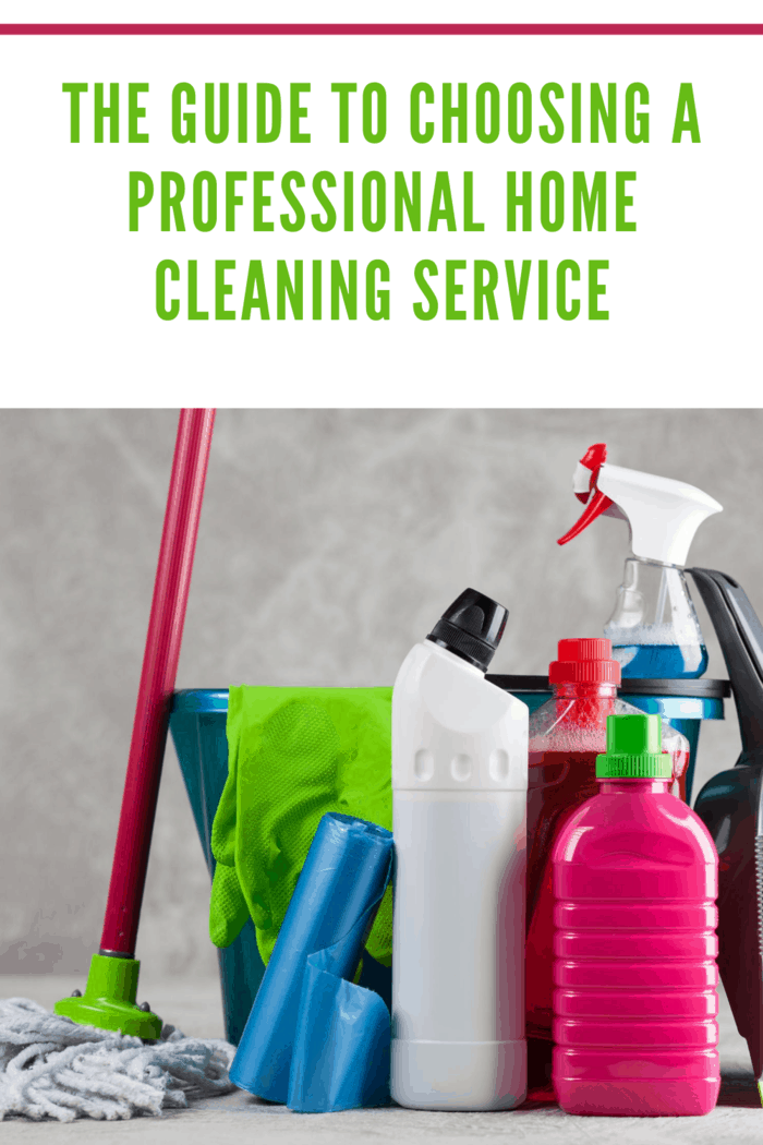 cleaning supplies like mop, brushes, spray bottles of cleaners and bucker