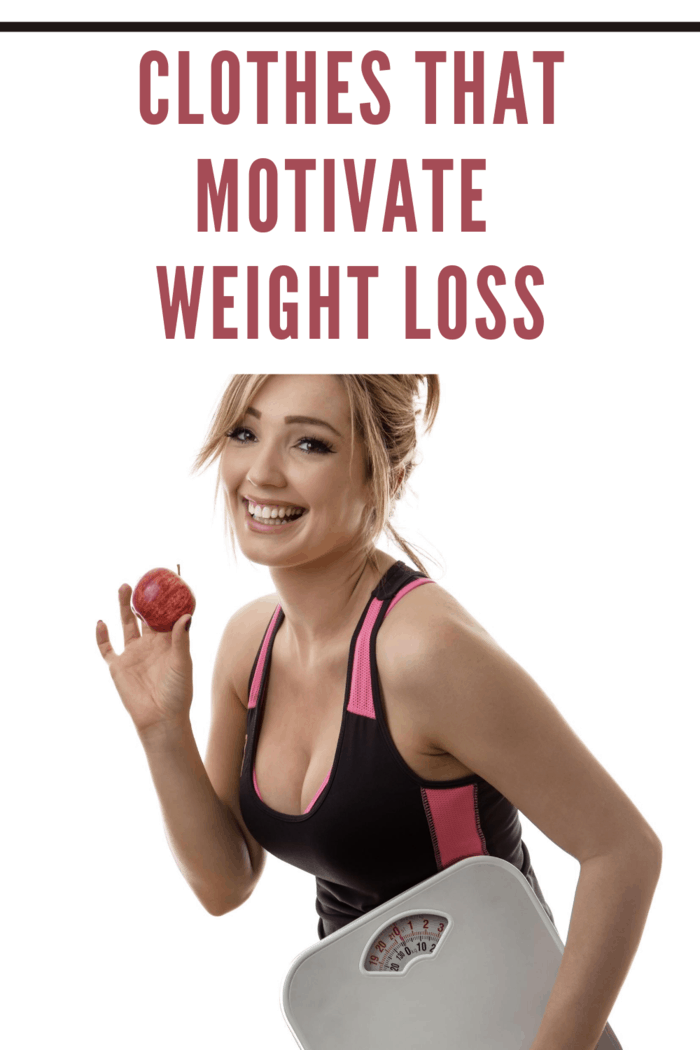 happy fitness woman holding scales in clothes that motivate weightloss