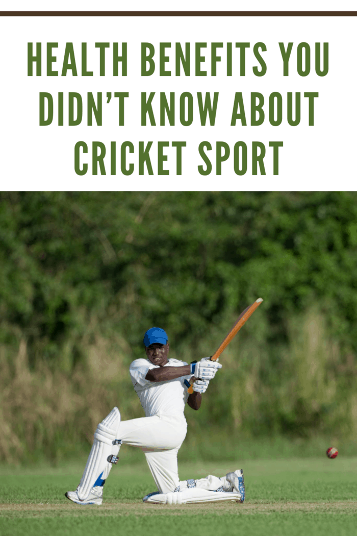 'Cricket action, batsman playing a sweep shot watched by the wicketkeeper.'