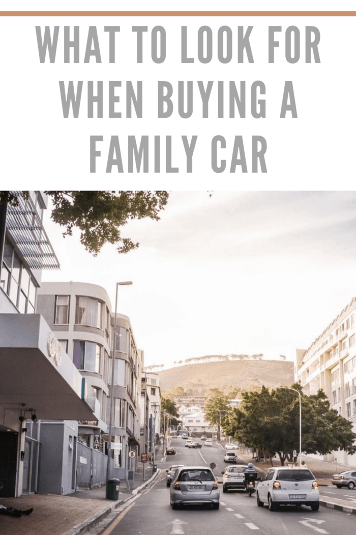 family cars driving in city at twilight