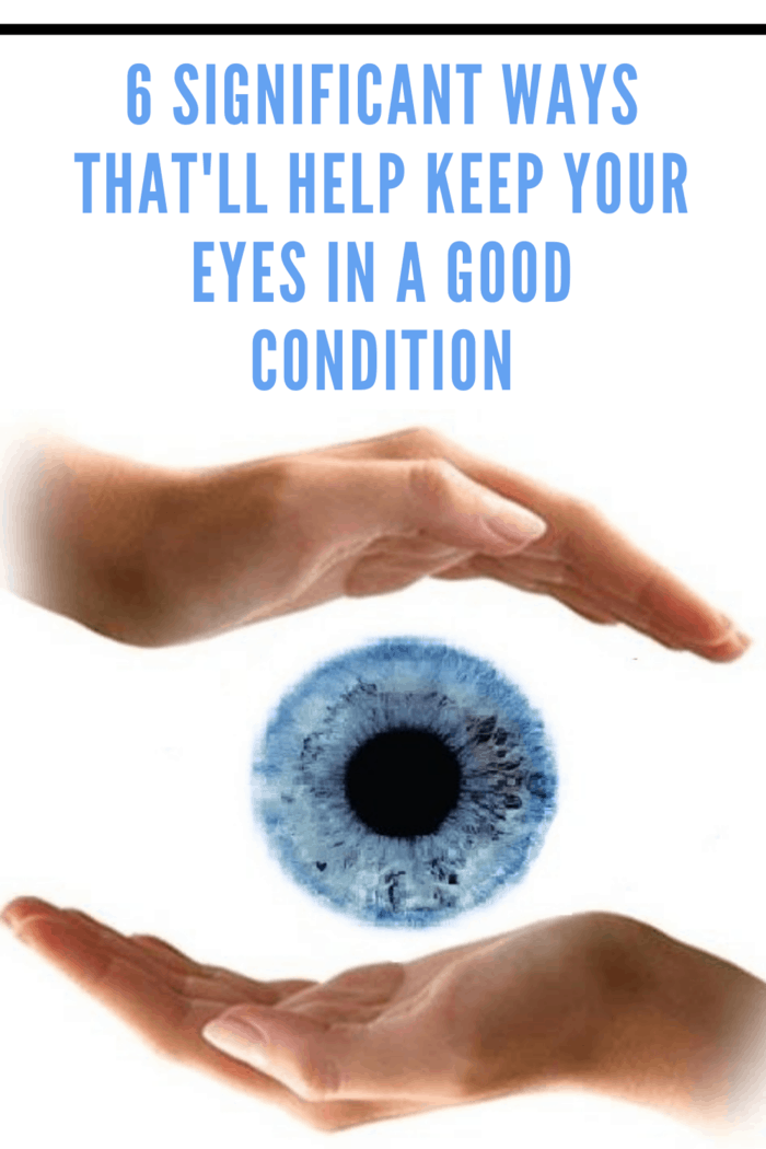 blue eye on white background between two hands