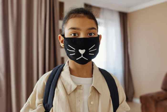 Little Girl Wearing a Face Mask for kids With a Design