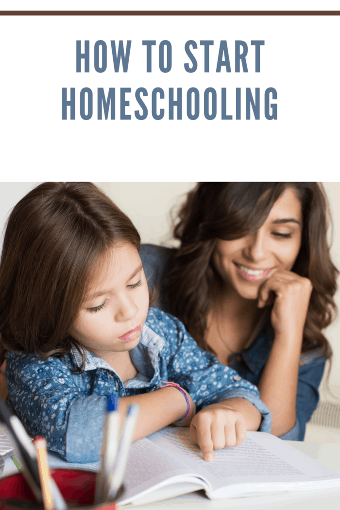 Mother helping her little child with homeschooling