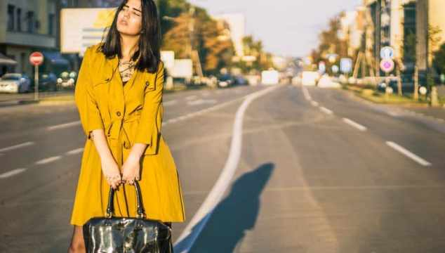 Woman Standing On Road Holding Leather Handbag