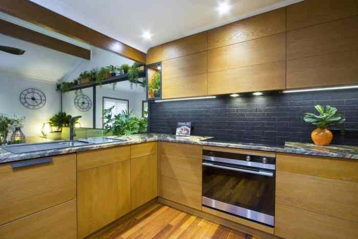 urban kitchen with oak cabinets and black backsplash