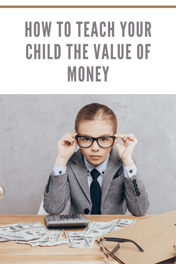 child dressed as businessperson learning the value of money