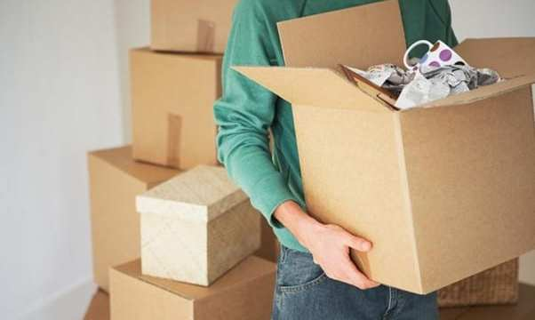 person packing breakables when relocating to a new city