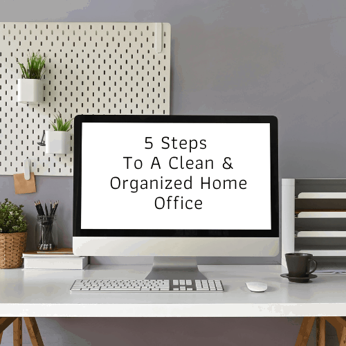 """Workspace Computer monitor with white screen that says """"% steps to a clean and organized home office"""" putting on working desk and surrounded by bookshelf, mouse, keyboard, coffee cup."""