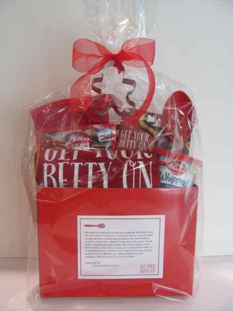 """Happy holidays from Betty Crocker!  We are inviting you to participate in our #GetYourBettyOn giveaway this baking season.  We created a basket filled with baking goodies for you and one lucky reader. The basket (image attached) includes: Kitchen tablet stand Betty Crocker™ Mixing Spoon Betty Crocker™ Oven Mitt """"Get Your Betty On"""" Apron Gingerbread Cookie Cutter Betty Crocker™ Sugar Cookie Mix Betty Crocker™ Chocolate Chip Cookie Mix Betty Crocker™ Whipped Vanilla Frosting Betty Crocker™ Holiday Recipe Booklet 2014 – feat. The Top 10 Cookie Decorating Ideas of 2014 We're all about sharing the memories of baking cookies with kids this season, and pulled together a helpful online Kid's Cookie Corner featuring our Top 10 cookies for kids and short, inspirational/how-to videos on each. If you want to try any of these recipes as part of the giveaway, by all means, we welcome your take on these tasty morsels! #GetYourBettyOn"""
