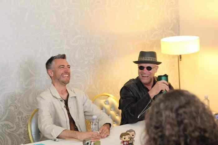 Sean Gunn laughing with Michael Rooker