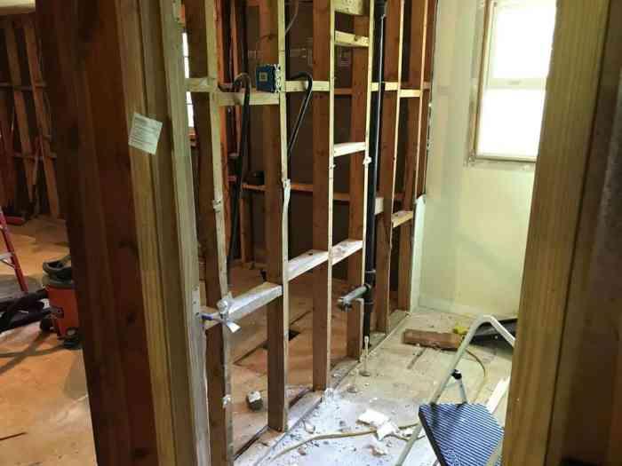 dad's house bathroom demolition looking through to kitchen