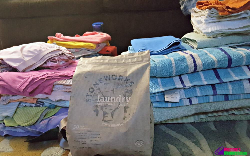 grab green laundry detergent with piles of clean laundry